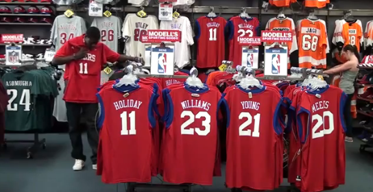 Working At Modell's For A Day, Jrue Holiday Gets Asked For A Roy Halladay Shirt
