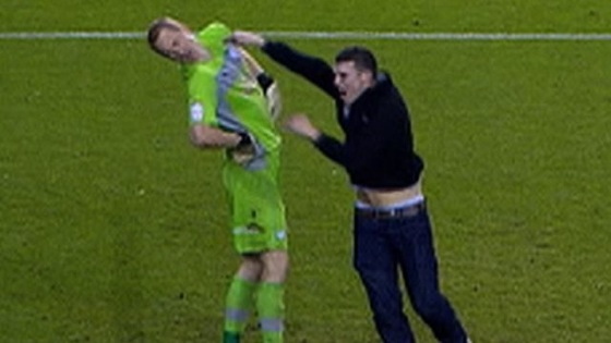 Fan Assaults Goalkeeper During English Championship League Match (Updated)