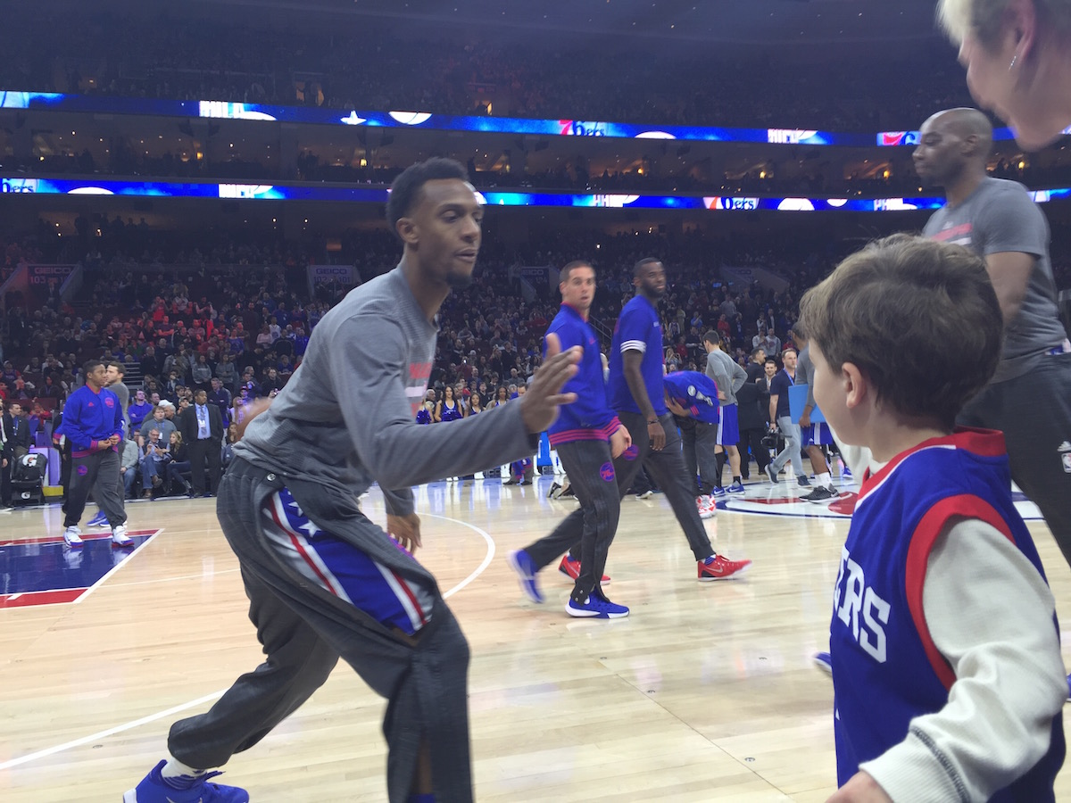 Ish Smith high fives Louden during pregame warmups.